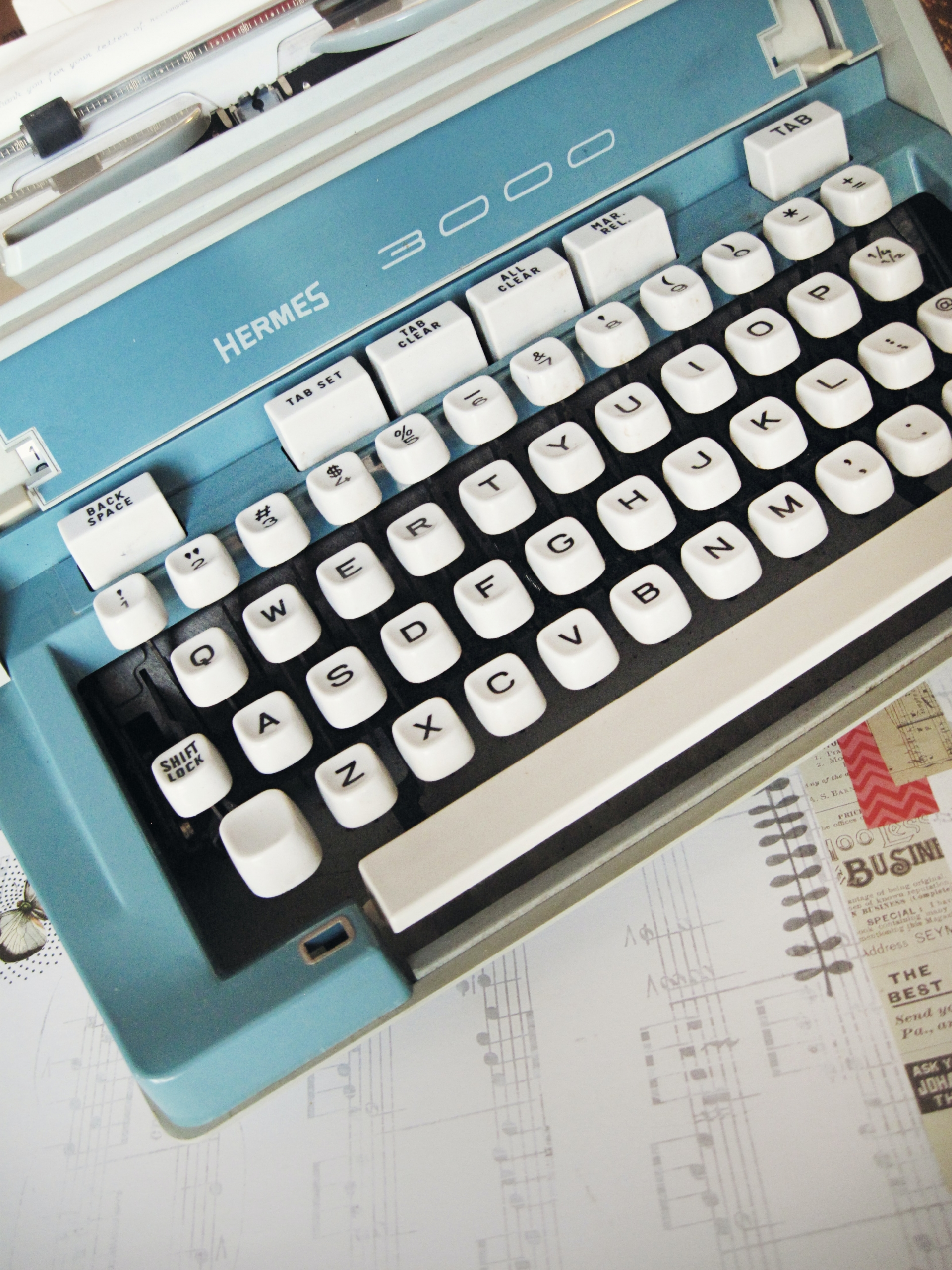 Close up on blue vintage type writer