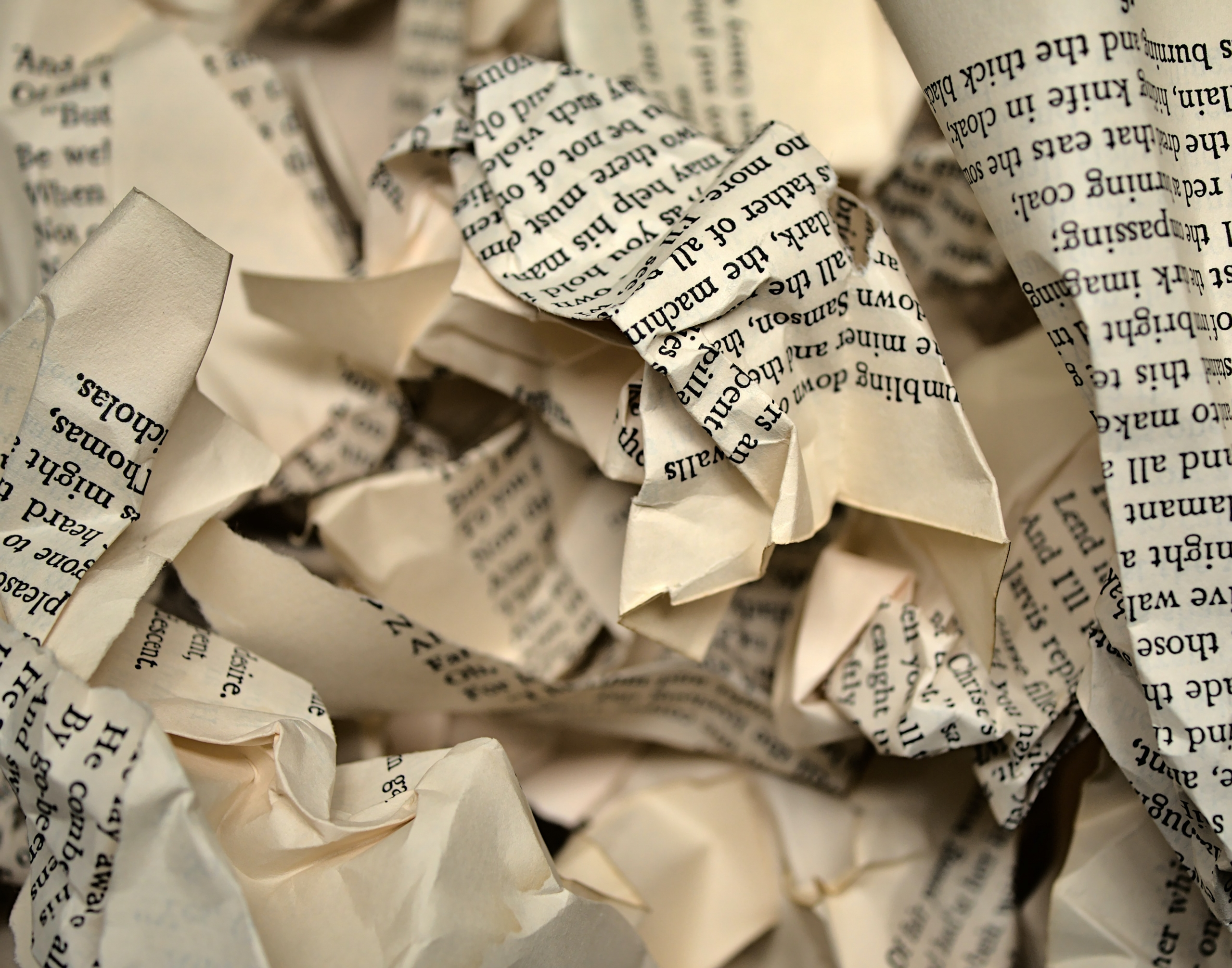 torn paper in a pile